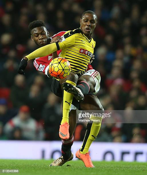 Timothy FosuMensah of Manchester United in action with Odion Ighalo of Watford during the Barclays Premier League match between Manchester United and...