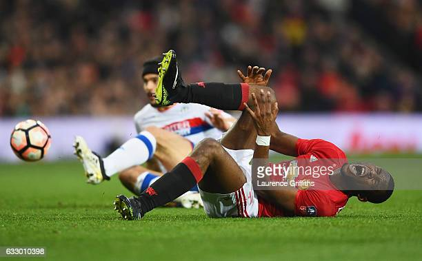 Timothy FosuMensah of Manchester United is fouled by Sam Morsy of Wigan Athletic during the Emirates FA Cup Fourth round match between Manchester...