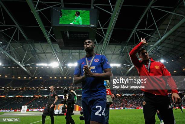 Timothy FosuMensah of Manchester United leaves the pitch following victory in the UEFA Europa League Final between Ajax and Manchester United at...