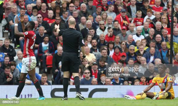 Timothy FosuMensah of Manchester United reacts to being penalised for a foul on Wilfried Zaha of Crystal Palace during the Premier League match...
