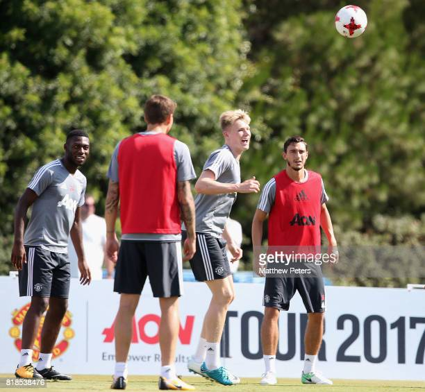 Timothy FosuMensah Scott McTominay and Matteo Darmian of Manchester United in action during a first team training session as part of their preseason...