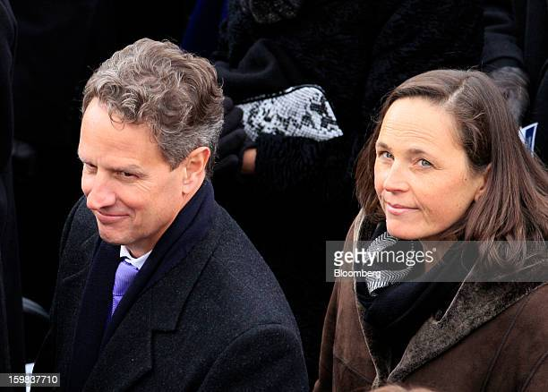 Timothy Geithner US treasury secretary left and his wife Carole Sonnenfeld Geithner attend the US presidential inauguration in Washington DC US on...