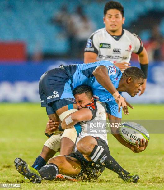 Timothy Lafaele of the Sunwolves tackles Warrick Gelant of the Blue Bulls during the Super Rugby match between Vodacom Bulls and Sunwolves at Loftus...