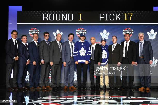 Timothy Liljegren 17th overall pick of the Toronto Maple Leafs poses for a photo onstage with the Leafs draft team during Round One of the 2017 NHL...