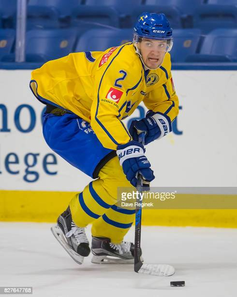 Timothy Liljegren of Sweden skates up ice with the puck against USA during a World Jr Summer Showcase game at USA Hockey Arena on August 2 2017 in...