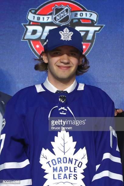 Timothy Liljegren poses for photos after being selected 17th overall by the Toronto Maple Leafs during the 2017 NHL Draft at the United Center on...