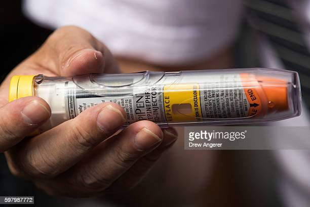Timothy Lunceford Stevens who suffers from autoimmune diseases and allergies holds an EpiPen as he speaks to reporters during a protest against the...