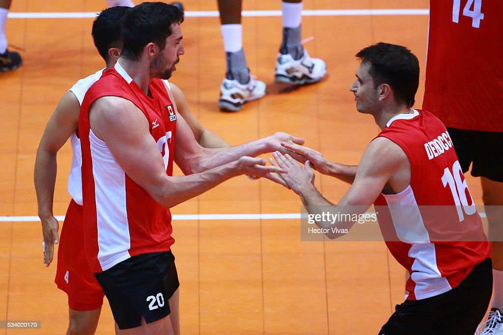 Timothy Maar and Jason Derocco of Canada celebrate during a match between USA and Canada as part of Men's Panamerican Volleybal Cup at Gimnasio Ol'mpico Juan de la Barrera on May 24, 2016 in Mexico City, Mexico.