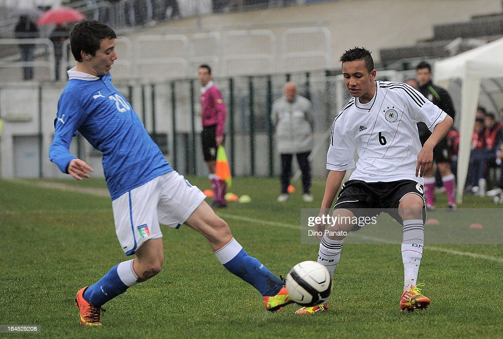 Timothy Mason (R) of Germany U15 competes with Francesco Di Nolfo of Italy U15 during the International U15 Tournament match between U15 Germany and U15 Italy at Stadio Tognon on March 24, 2013 in Fontanafredda, Italy.