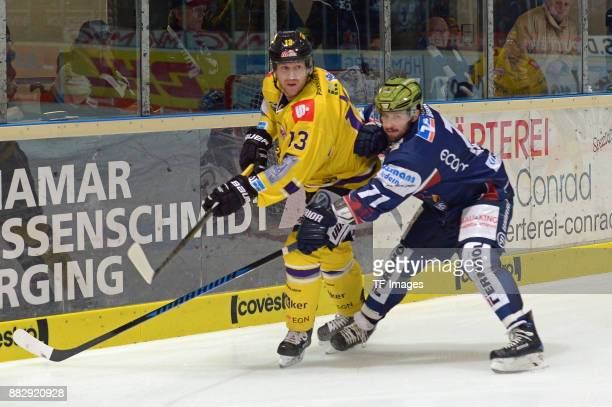 Timothy Miller of Krefeld Pinguine and Travis Turnbull of Iserlohn Roosters battle for the ball during the DEL match between Iserlohn Roosters and...