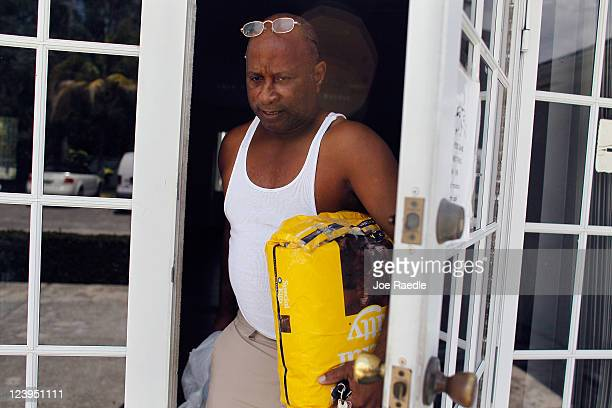 Timothy Patterson carries bags of dog food as he leaves Fido's Food Bank at the Peggy Adams Animal Rescue League on September 6 2011 in Palm Beach...