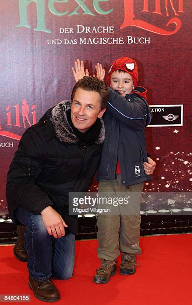 Timothy Peach and his son Nelson pose for the media during the premiere of the movie 'Lilli The Witch The Dragon And The Magical Book' on February 15...