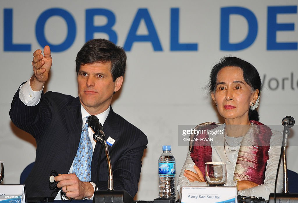 Timothy Perry Shriver (L), chairman and CEO of the Special Olympics, gesture to the media with Aung San Suu Kyi (R), Myanmar's opposition leader, during a press conference of The Global Development Summit, held on the sidelines of the 10th Special Olympics World Winter Games in Pyeongchang, about 180 km east of Seoul on January 30, 2013. The democracy leader and Nobel peace laureate was a guest of honour at the opening of the Special Winter Olympics in the northeastern mountain resort of Pyeongchang -- the site of the full 2018 Winter Games.