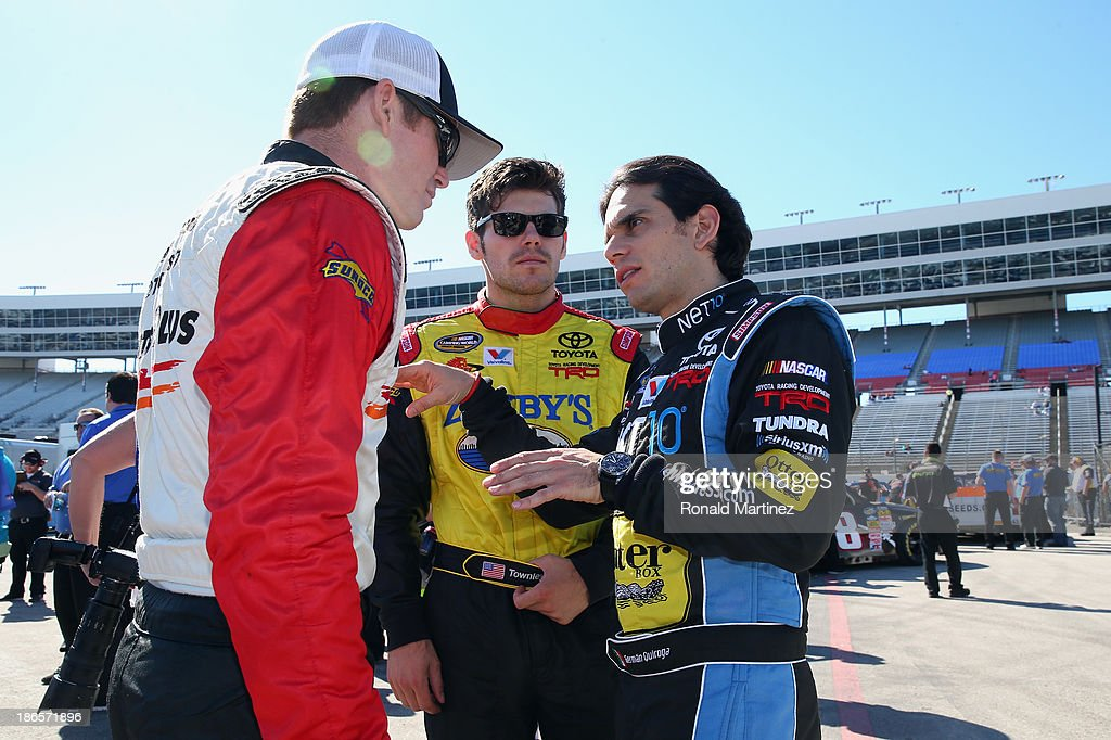 Timothy Peters, driver of the #17 Parts Plus Toyota, talks with John Wes Townley, driver of the #7 Zaxby's Toyota, and German Quiroga, driver of the #77 OtterBox / NET10 Wireless Toyota, during qualifying for the NASCAR Camping World Truck Series WinStar World Casino 350k at Texas Motor Speedway on November 1, 2013 in Fort Worth, Texas.