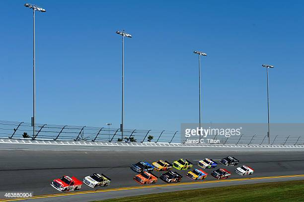 Timothy Peters driver of the Red Horse Racing Toyota leads a pack of trucks practice for the NASCAR Camping World Truck Series NextEra Energy...