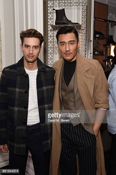 Timothy Renouf and Hu Bing attend a drinks reception hosted by Christian Louboutin to celebrate new members of The Ecusson Club during London Fashion...
