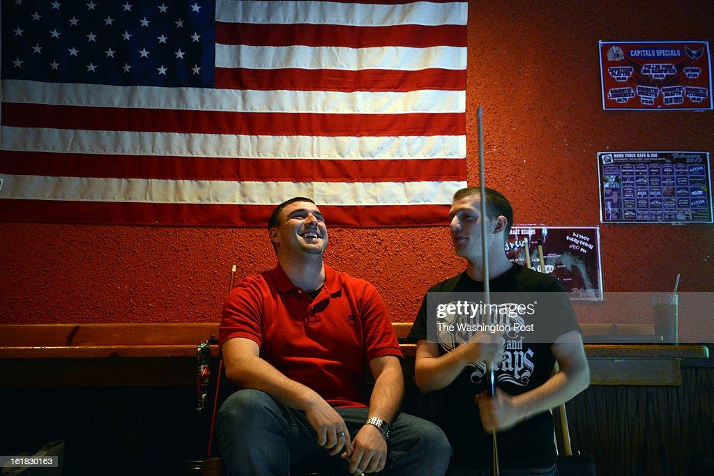 Timothy Smith, L, of Woodbridge, and Devon Goeller, of Lorton, VA, talk between rounds of pool at Hard Times Cafe on Monday, February 4, 2012, in Woodbridge, VA. Smith didn't want to comment on the issue of immigration, but Goeller said, 'I think immigration is great, but if you're going to want to live here, in my personal opinion, you should want to become a citizen. And if there's ways for the government to help you become a citizen, take them. But if you're just trying to move here and not become a citizen, unless you have a visa, then i don't agree with what you're doing.' Prince William County was a key battleground for immigration in the Washington area. Now the area is home to many working and middle class immigrants, both legal and not.