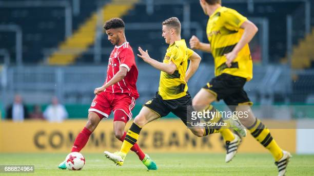 Timothy Tillman and Julian Schwermann of Dortmund fight for the ball during the U19 German Championship Final between Borussia Dortmund and FC Bayern...