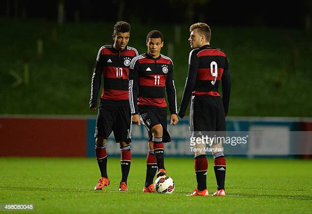 Timothy Tillman Chinedu Ekene and Manuel Wintzheimer of Germany prepare to kick off the second half during the U17s International Friendly match...