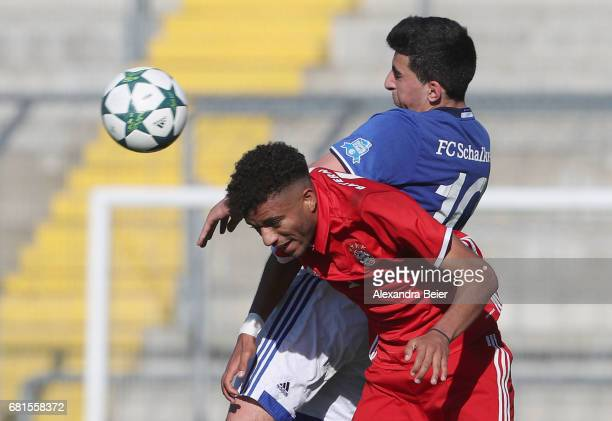 Timothy Tillman of FC Bayern Muenchen heads for the ball with Nassim Boujellab of FC Schalke 04 during the AJuniors semi final first leg German...
