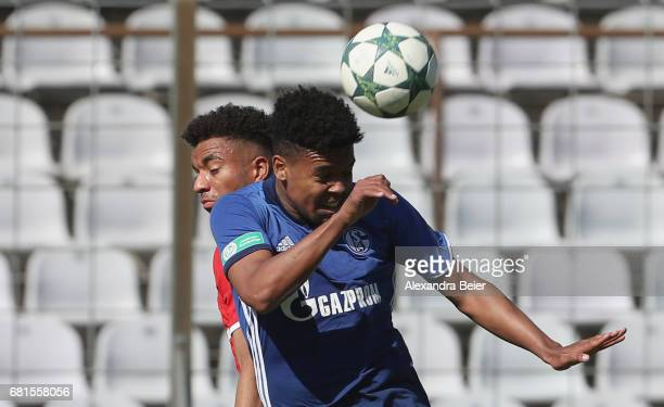 Timothy Tillman of FC Bayern Muenchen heads for the ball with Weston Mc Kennie of FC Schalke 04 during the AJuniors semi final first leg German...