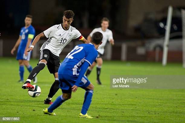 Timothy Tillman of Germany challenges Teva Baret of Israel during the Under 18 International Friendly match between Israel and Germany on December 13...