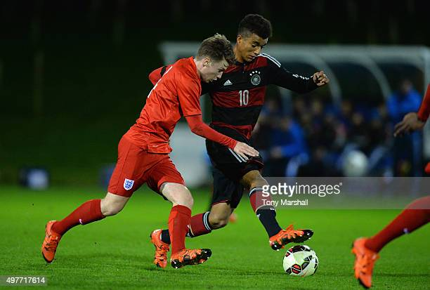 Timothy Tillman of Germany is tackled by Callum Slattery of England during the U17s International Friendly match between England U17 and Germany U17...