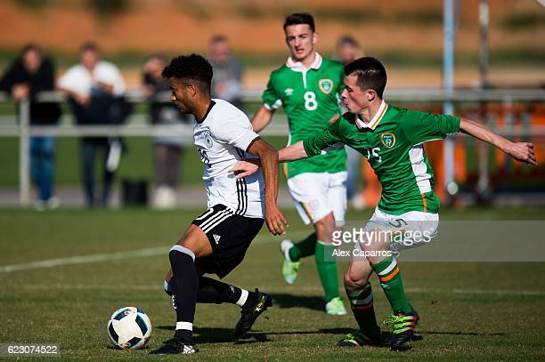 Timothy Tillman of Germany protects the ball from Jack Clarke of Ireland during the U18 international friendly match between Ireland and Germany on...
