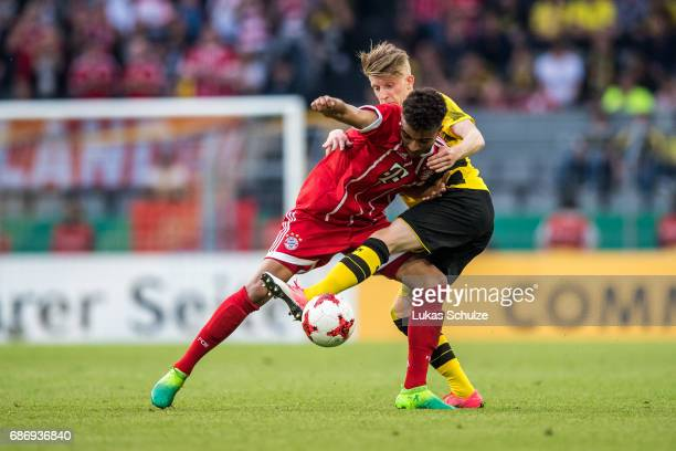 Timothy Tillman of Munich and JanNiklas Beste of Dortmund of Dortmund fight for the ball during the U19 German Championship Final between Borussia...