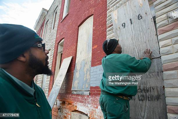 BALTIMORE MD DECEMBER 18 Timothy Veal left Crew Chief at East Baltimore Development Inc and Perry Santos Maintenance Tech board up one of the many...