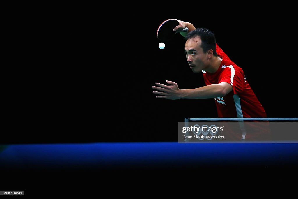 Timothy Wang of Team USA looks at the ball as he gets ready to serve at the Table Tennis practice session during the Olympics preview day - 2 at Rio Centro on August 3, 2016 in Rio de Janeiro, Brazil.