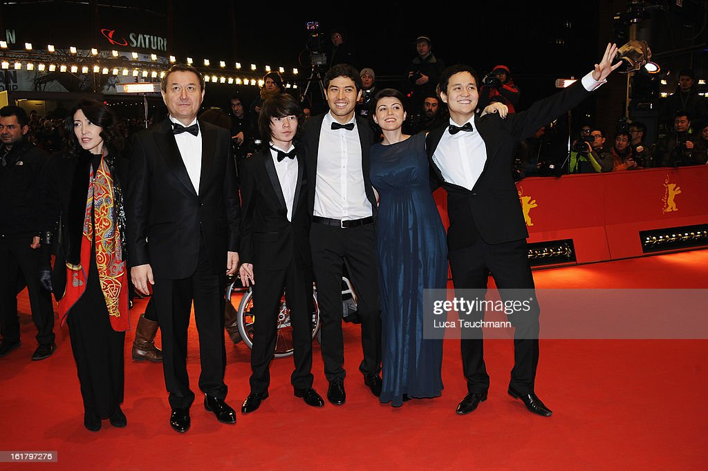 Timur Aidarbekov, (2nd R) producer Anna Katchko and (1st R) director Emir Baigazin attend the Closing Ceremony of the 63rd Berlinale International Film Festival at Berlinale Palast on February 14, 2013 in Berlin, Germany.