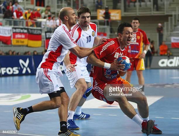 Timur Dibirov of Russia tackles Vladimir Temelkov of Macedonia during the Men's World Handball Championships match between Macedonia and Russia at...