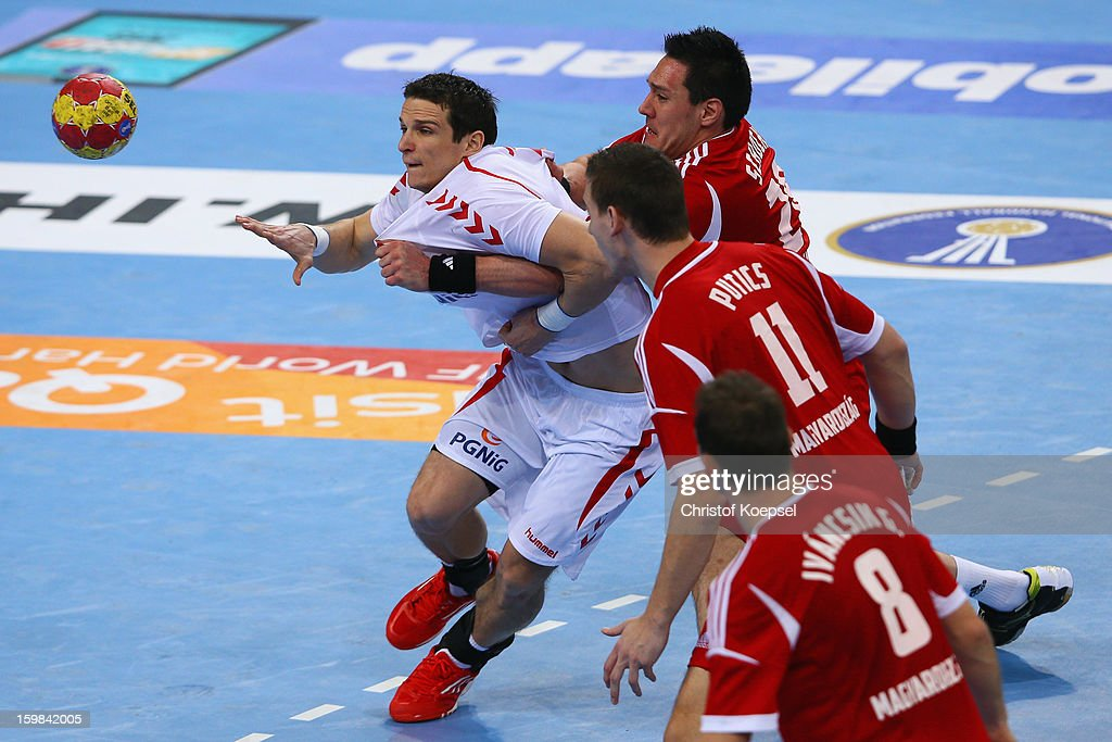 Timuzsin Schuch of Hungary (R) defends against Bartolomiej Jaszka of Poland (L) during the round of sixteen match between Hungary and Poland at Palau Sant Jordi on January 21, 2013 in Barcelona, Spain.