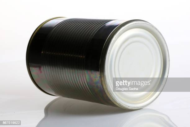 Tin can of preserved food on a white background