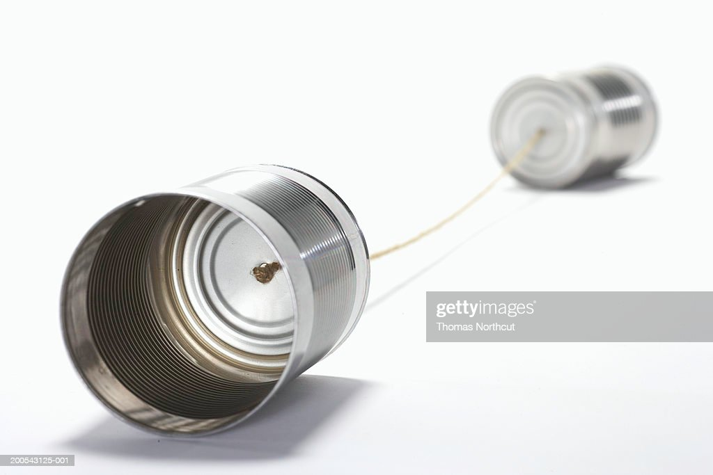 Tin can phone (focus on can in foreground) : Stock Photo