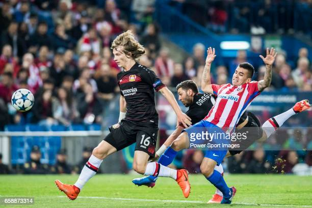 Tin Jedvaj of Bayer 04 Leverkusen battles for the ball with Angel Correa of Atletico de Madrid during their 201617 UEFA Champions League Round of 16...