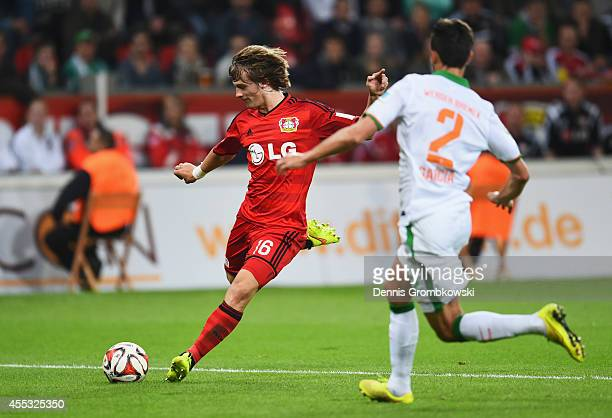 Tin Jedvaj of Bayer Leverkusen shoots past Santiago Garcia of Werder Bremen to score their first goal during the Bundesliga match between Bayer 04...
