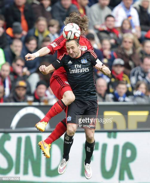 Tin Jedvaj of Leverkusen and Petr Jiráek of Hamburg battle for the balll during the Bundesliga match between Bayer 04 Leverkusen and Hamburger SV at...