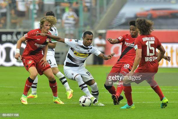 Tin Jedvaj of Leverkusen and Raffael of Moenchengladbach and Wendell of Leverkusen and Julian Baumgartlinger of Leverkusen battle for the ball during...