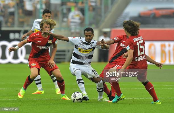 Tin Jedvaj of Leverkusen and Raffael of Moenchengladbach and Wendell of Leverkusen and Julian Baumgartlinger of Leverkusen battle for the ball during...
