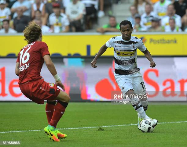 Tin Jedvaj of Leverkusen and Raffael of Moenchengladbach battle for the ball during the Bundesliga match between Borussia Moenchengladbach and Bayer...