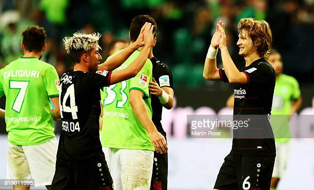 Tin Jedvaj of Leverkusen celebrate with team mate Kevin Kampl after the Bundesliga match between VfL Wolfsburg and Bayer 04 Leverkusen at Volkswagen...
