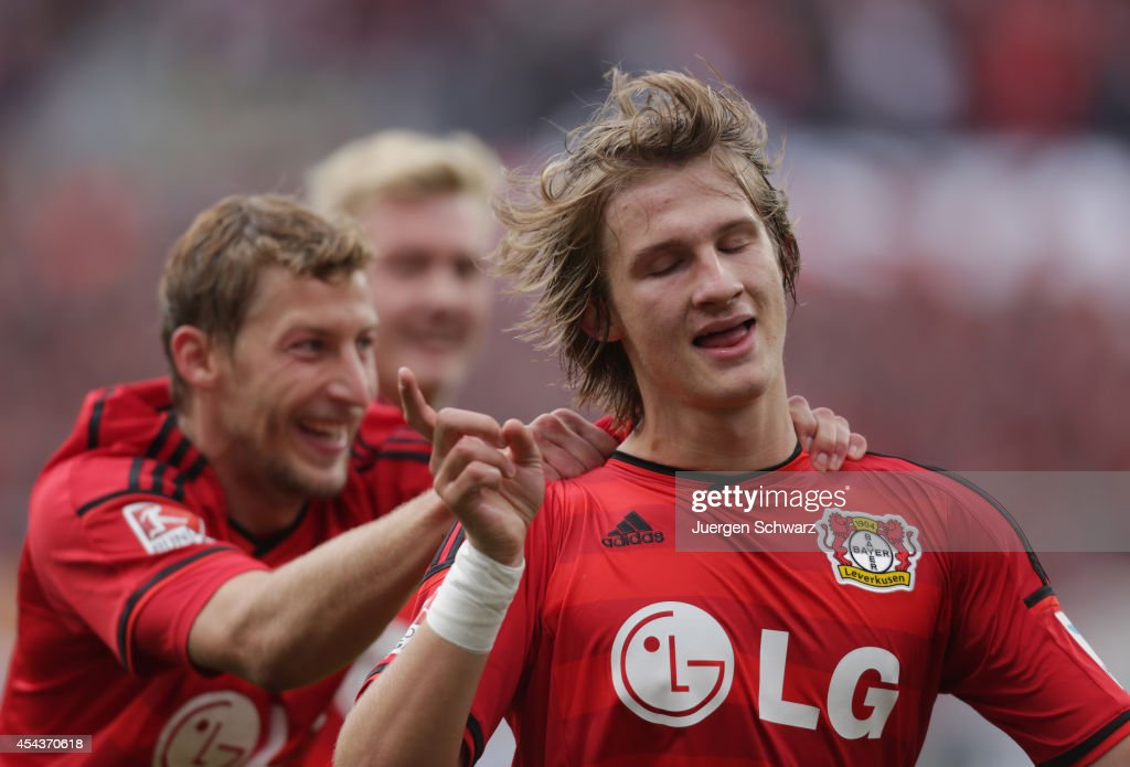Tin Jedvaj of Leverkusen (R) is hugged bay Stefan Kiessling after scoring during the Bundesliga match between Bayer Leverkusen and Hertha BSC Berlin at BayArena on August 30, 2014 in Leverkusen, Germany.