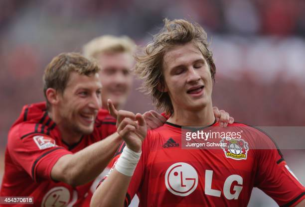 Tin Jedvaj of Leverkusen is hugged bay Stefan Kiessling after scoring during the Bundesliga match between Bayer Leverkusen and Hertha BSC Berlin at...