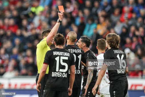Tin Jedvaj of Leverkusen is shown a red card by referee during the Bundesliga match between Bayer 04 Leverkusen and Bayern Muenchen at BayArena on...