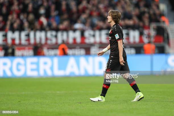 Tin Jedvaj of Leverkusen walks off the pitch after receiving a red card from referee during the Bundesliga match between Bayer 04 Leverkusen and...