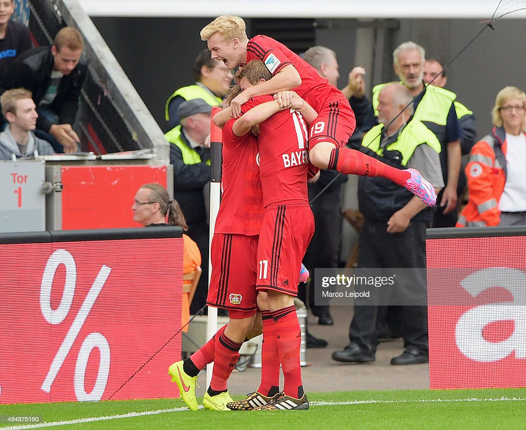 Tin Jedvaj, <a gi-track='captionPersonalityLinkClicked' href=/galleries/search?phrase=Stefan+Kiessling&family=editorial&specificpeople=605405 ng-click='$event.stopPropagation()'>Stefan Kiessling</a> and <a gi-track='captionPersonalityLinkClicked' href=/galleries/search?phrase=Julian+Brandt&family=editorial&specificpeople=7840042 ng-click='$event.stopPropagation()'>Julian Brandt</a> of Bayer 04 Leverkusen celebrate after scoring the 1:1 goal during the Bundesliga match between Bayer 04 Leverkusen and Hertha BSC on at BayArena on August 30, 2014 in Leverkusen, Germany.