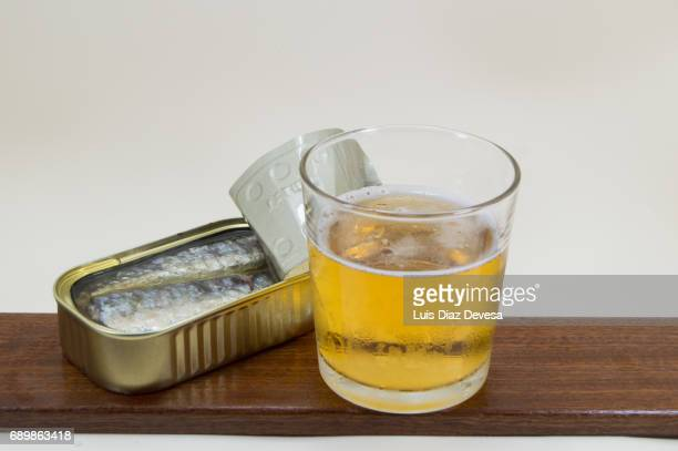 tin of sardines in olive oil and glass of beer