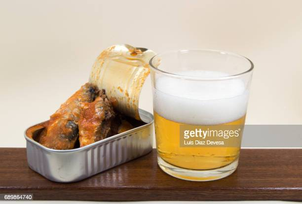 tin of sardines in tomato sauce and glass of beer